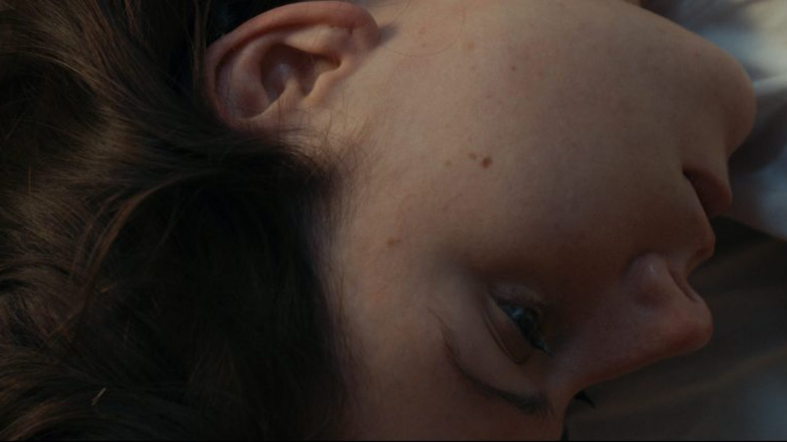 Siren promo still - Elizabeth in bed